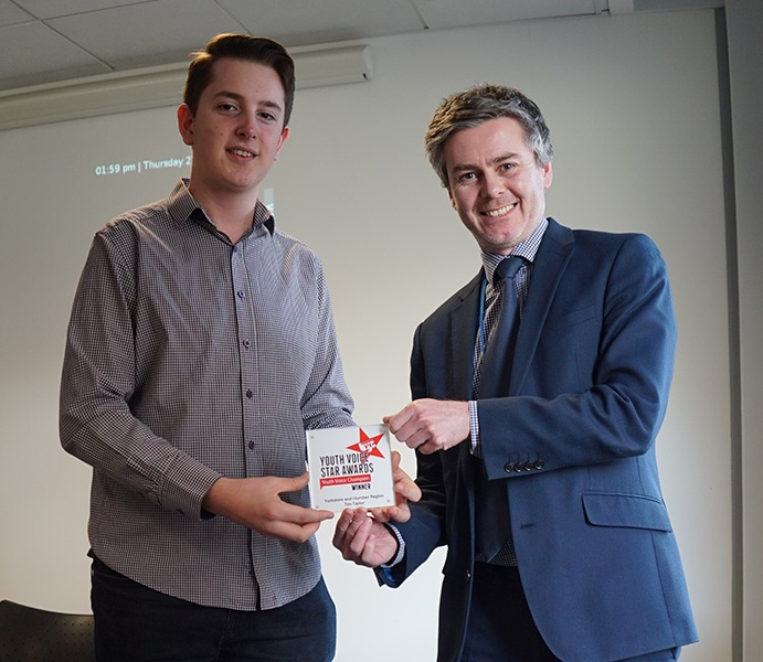 Tim Taylor receiving the Youth Voice Champion Award